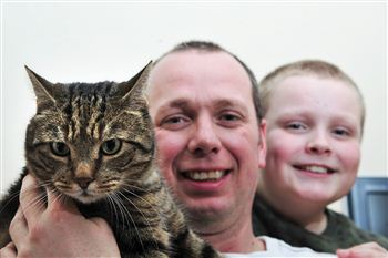Spud with his owners Kevin Stickings and his son