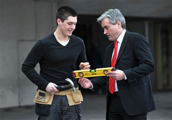 Oliver Beatson shows Iain Gray how to use a spirit level
