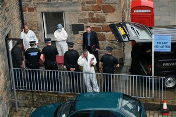 PROBE: police removed two bodies from flat