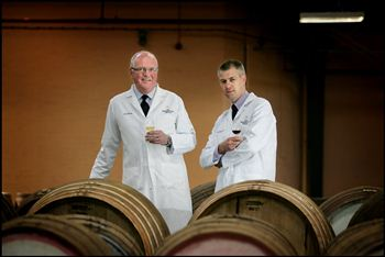 John Ramsay (left) is passing on the whisky glass to Gordon Motion (right)