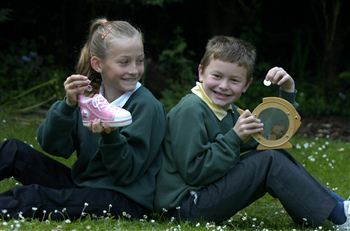 Laura Thomson, 9 and Iain Jackson, 7, are chipping in