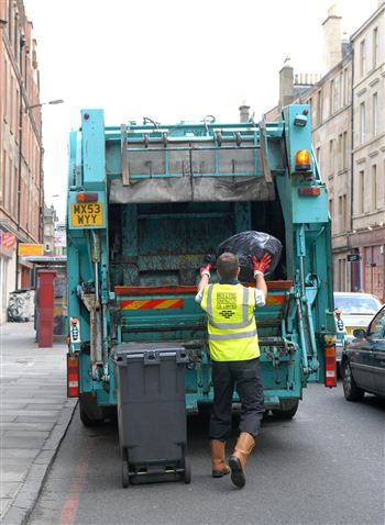 Contractors collect the overflowing waste