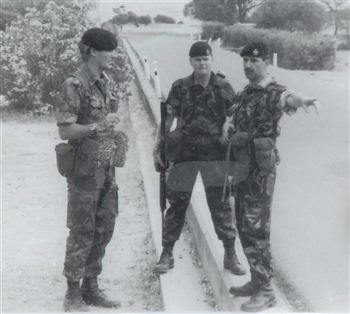 Former Lt Cnl Crawford (left) discussing a roadside bomb in Cyprus