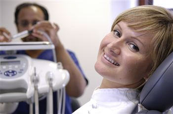 Biju prepares to treat a patient