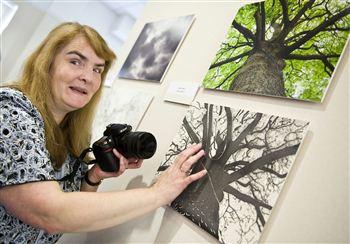Rosita McKenzie checks out her artwork