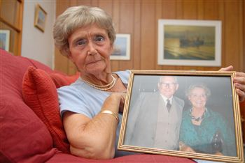 Margaret Peterson with a picture of her and Charles in happier times