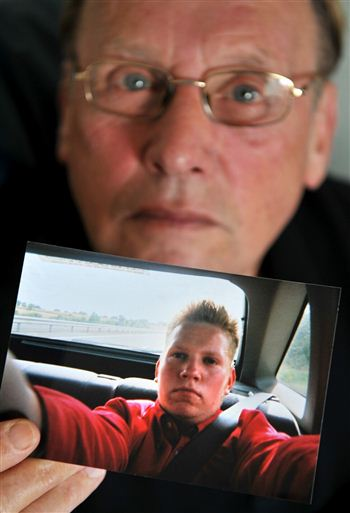 Bernard Boylan with picture of missing son John