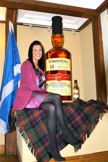 World's Largest Whisky Bottle - with Tomintoul Distillery employee Nikki Brand