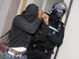 A policeman apprehends a criminal- Scottish crime news