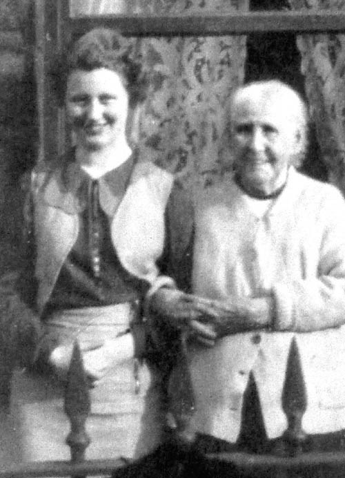 Connie (left) in her 20s standing with her grandmother