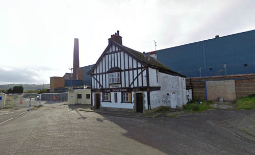 The pub before demolition workers moved in on the paper mill behind