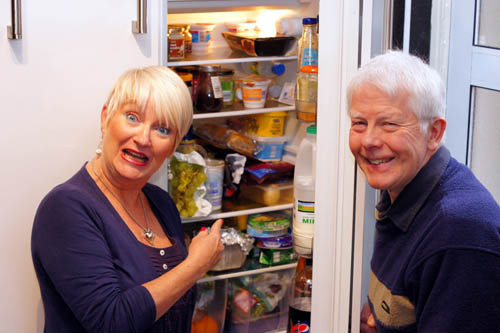 Beverley and David Cooper, beside their fridge where the spider was found.