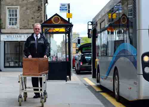 A bus load of passengers get a foretaste of their own final journeys