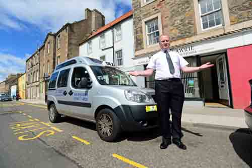 Taxis can now stop directly outside his premises - but not Mr Lawrie.