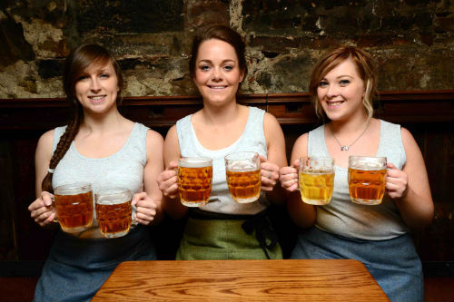 Staff members Louise Kennedy, Louise Downie and Laura O'Biren enjoy a celebratory pint