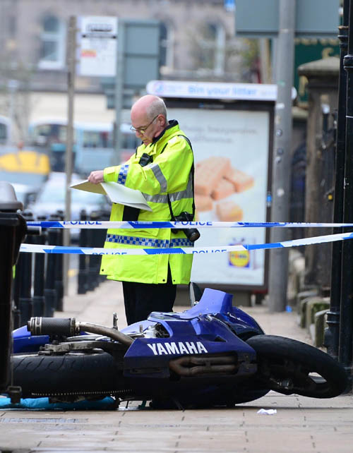 It is believed the motorcycle was forced onto the pavement after colliding with a car