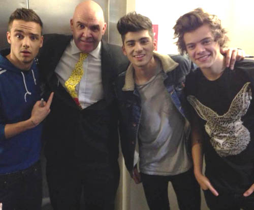 Charlie Kean with the One Direction stars. Zayn's mother organised the toybox  for the oncology ward at Ninewells