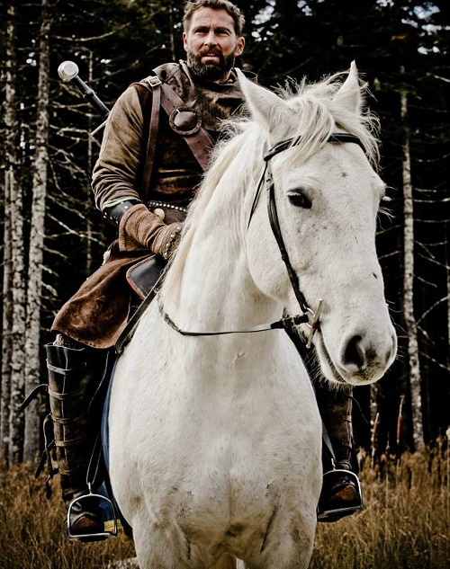 Robert the Bruce astride a white horse in the Canadian production
