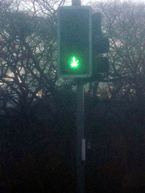 Pranksters caused many giggles after transforming a traffic light with a stencil