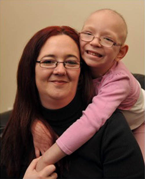 Holly, pictured with her mum Vicky, will be hosting two fun days in their village to reach their £1000 total