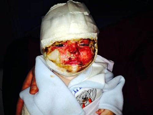 The youngster was found in the ruined remains of his home in Pakistan on December 16