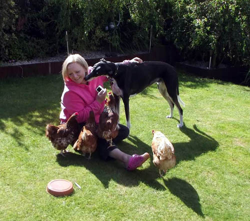 Fiona McGravie with pet dog Colin and the first hens they rescued