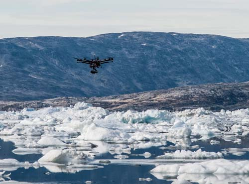 Pilot Phil Tarry flies a DJI S1000 Octocopter off an Iceberg wit