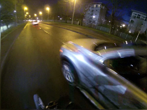 The driver passes extremely close to the cyclist