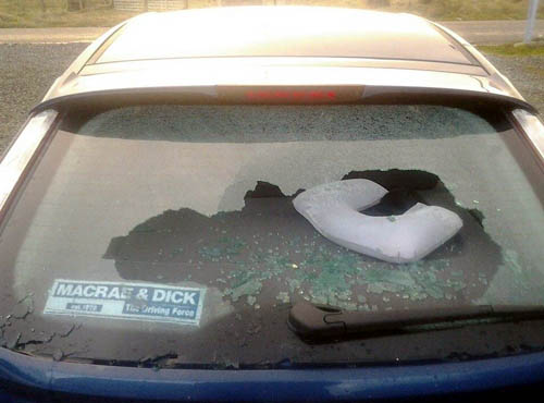 The hailstones smashed the rear windscreen of a car