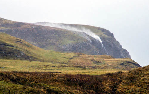 A waterfall on the Isle of Skye goes with the flow - being blown skyward by gale-force winds