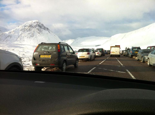 Cars lined both sides of the A82
