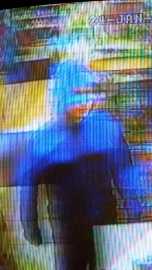 The robber tried to disguise himself with a blue plastic bag