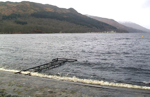 The high water levels toppled the statue and destroyed the jetty
