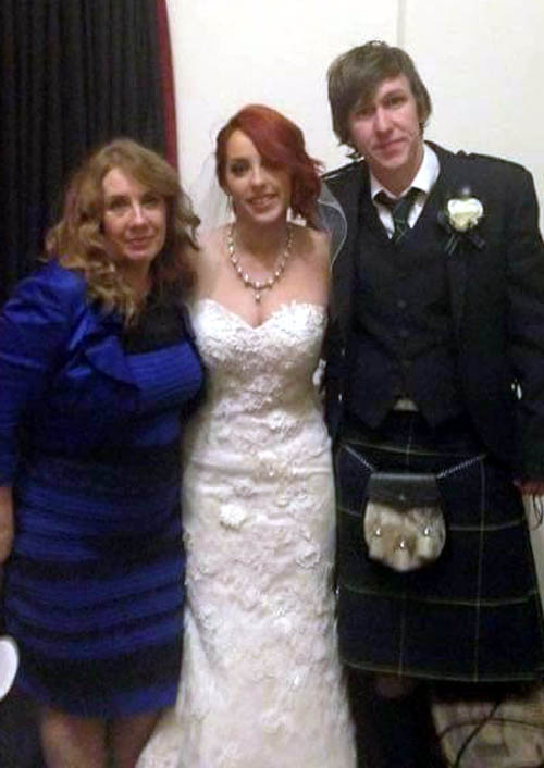 Cecelia, left, with her daughter and son-in-law at the wedding, wearing what would turn out to be the world's most controversial dress