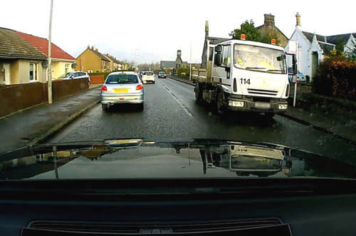 The oncoming council lorry approaching the driver with the dash-cam