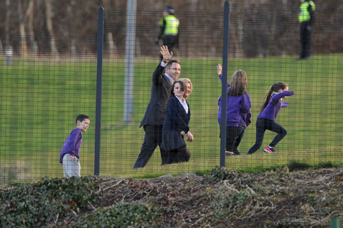 He appeared happy and jovial as he waved to youngsters