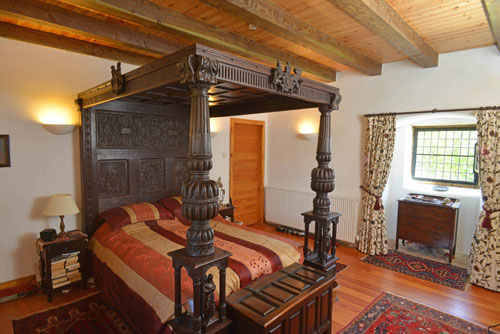 One of the four bedrooms in the castle