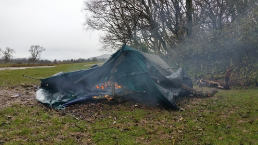 A tent left abandoned and on fire