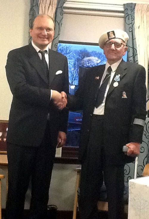 Alex Ramsay, 88, was presented with his medal by Andrey Pritsepov, the Consul General