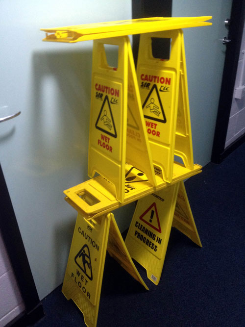 "The students also have six ""wet floor"" signs and a signpost"