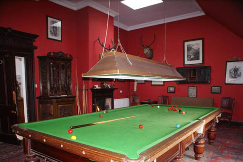 A room with a pool table in it in the estate -Business News Scotland