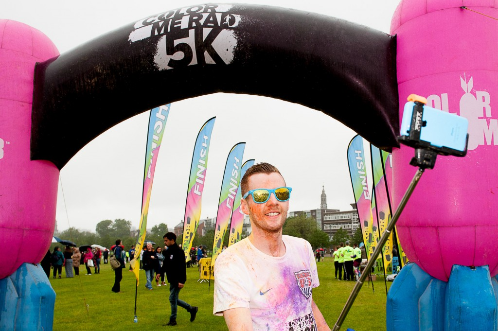 The popular Coulour Me Rad, charity 5K fun run had it's Glasgow leg in Glasgow Green on Sunday, 28th June, 2015. Despite some bad weather, thousands of runners and walkers turned out for a fun day. IN PIC................. Happy runner taking a selfie at the finishing line. (c) Wullie Marr/DEADLINE NEWS For pic details, contact Wullie Marr........... 07989359845