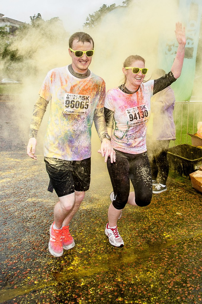 The popular Coulour Me Rad, charity 5K fun run had it's Glasgow leg in Glasgow Green on Sunday, 28th June, 2015. Despite some bad weather, thousands of runners and walkers turned out for a fun day. IN PIC................. Runners get hit with a different colour paint at various points on the course. Stephen and Debbie Fleming, both 23, who were married on Friday at Kilbarchan West church, starting their honeymoon with a fun run. The couple met while running with a club in Kilbarchan. (c) Wullie Marr/DEADLINE NEWS For pic details, contact Wullie Marr........... 07989359845