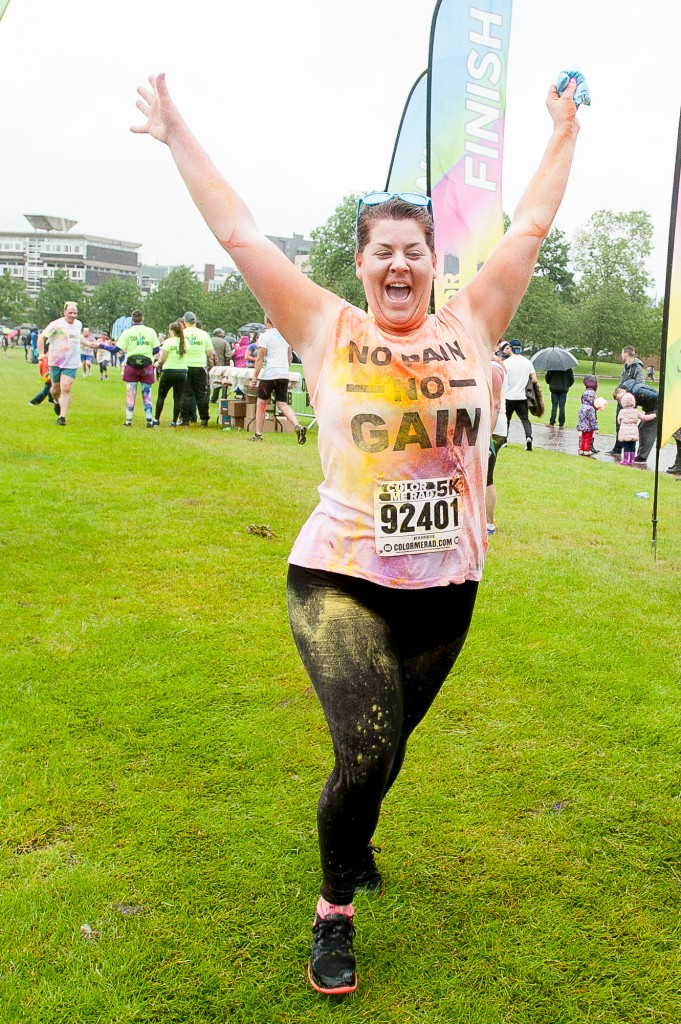 The popular Coulour Me Rad, charity 5K fun run had it's Glasgow leg in Glasgow Green on Sunday, 28th June, 2015. Despite some bad weather, thousands of runners and walkers turned out for a fun day. IN PIC................. Happy runner at the finishing line. (c) Wullie Marr/DEADLINE NEWS For pic details, contact Wullie Marr........... 07989359845