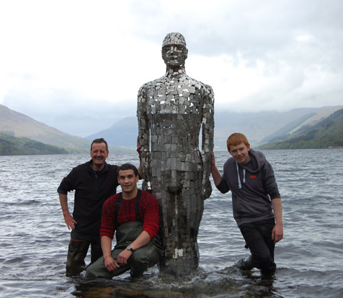Rob (left) with some friends who helped him put Still back in place