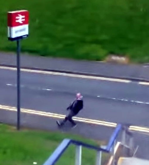 The man manages to fall over his own feet