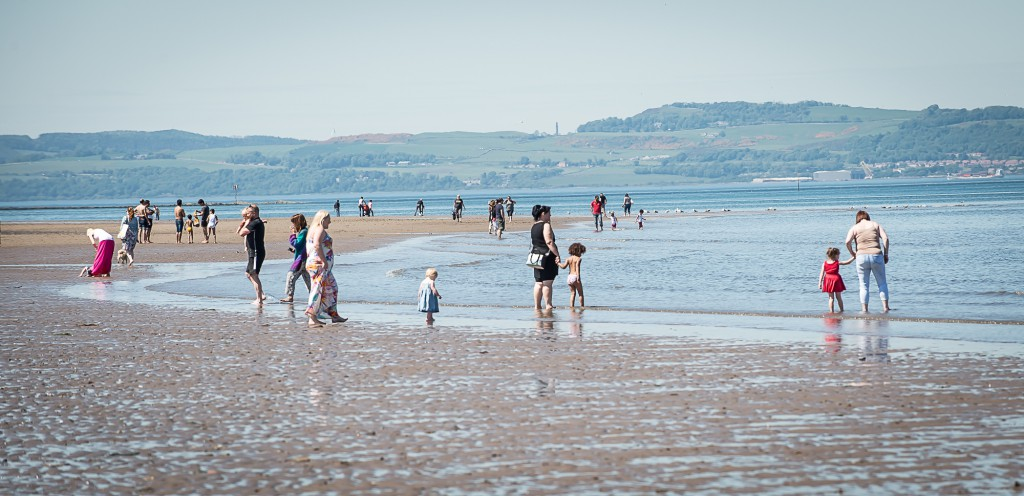 10th June, 2015, Edinburgh. As the summer starts to kick in, locals start to have some fun in the sun. IN PIC.........Locals take advantage of the warm weather at Portobello beach. (c) Wullie Marr/DEADLINE NEWS For pic details, contact Wullie Marr........... 07989359845