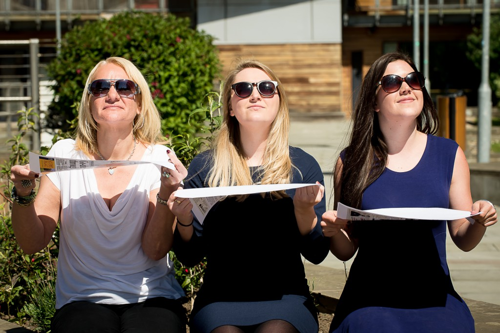10th June, 2015, Edinburgh. As the summer starts to kick in, locals start to have some fun in the sun. IN PIC......... Office workers, Lindsay Robertson, Sarah Fairley and Allie Simpson enjoy some sun on a tea break. (c) Wullie Marr/DEADLINE NEWS For pic details, contact Wullie Marr........... 07989359845