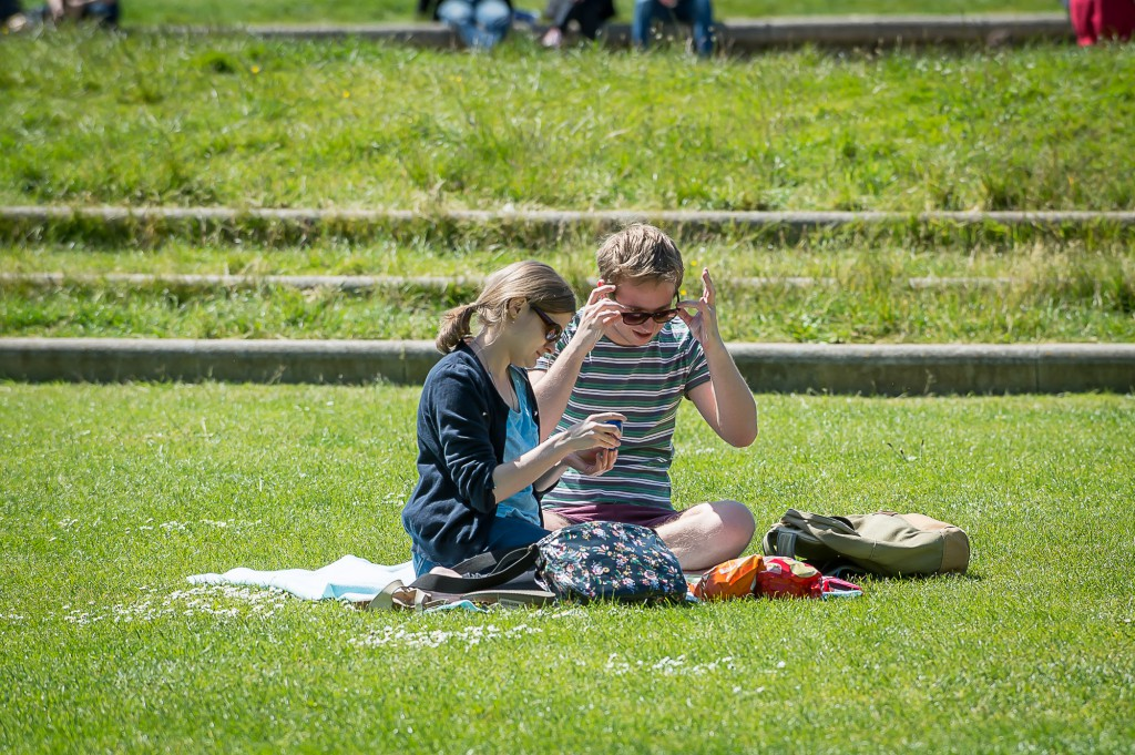 10th June, 2015, Edinburgh. As the summer starts to kick in, locals start to have some fun in the sun. IN PIC......... Locals make use of the green space outside the Scottish Parliament for their lunch breaks in the sun. (c) Wullie Marr/DEADLINE NEWS For pic details, contact Wullie Marr........... 07989359845