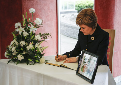 Ms Sturgeon signs a book of condolence